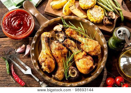 Grilled chicken drumsticks with vegetables