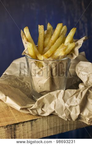 French Fries In A Paper Wrapper, Blue Background