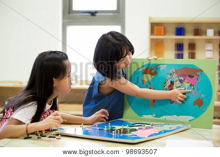 Little Asian Girl Looking South East Asia For Play Jigsaw