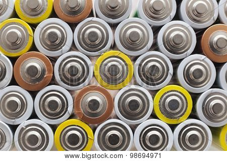 Large Amount Of Used Aa Batteries In Several Colors