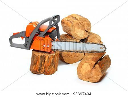 Cut logs fire wood and chainsaw isolated on white background.  Firewood as a renewable resource of a energy. Environmental concept.