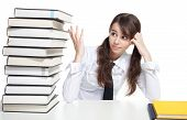picture of teen pony tail  - Sad school girl sitting with pile of books - JPG