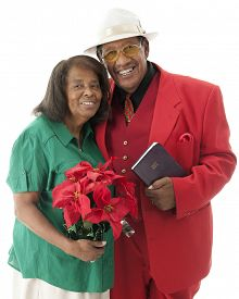 pic of poinsettia  - A happy senior couple dressed for Christmas - JPG