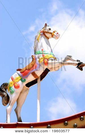 Carousel horse with blue sky background