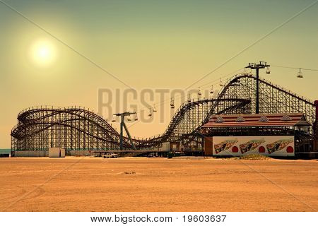 old fashioned wooden rollercoaster at dusk fall