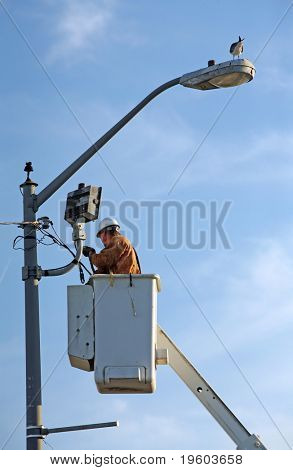 Electrician working on power line
