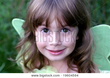 A close up of a beautiful young girl with big brown eyes, soft focus and shallow depth of field