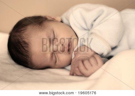 A cute baby taking a nap