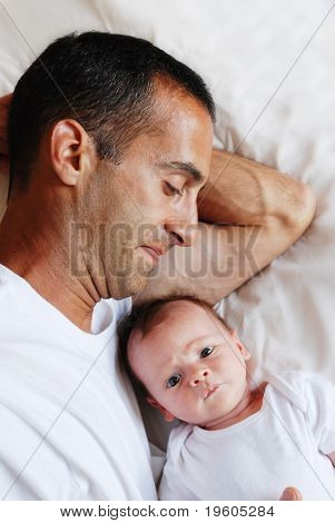 A father lying in bed with his son