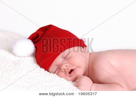 A portrait of a cute baby wearing a santa hat