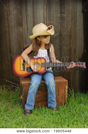 A cute girl playing a guitar
