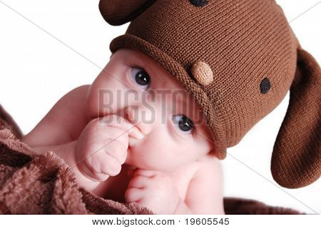A cute baby boy sucking his thumb