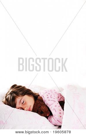 A cute young girl sleeping with her teddy bear,copy space