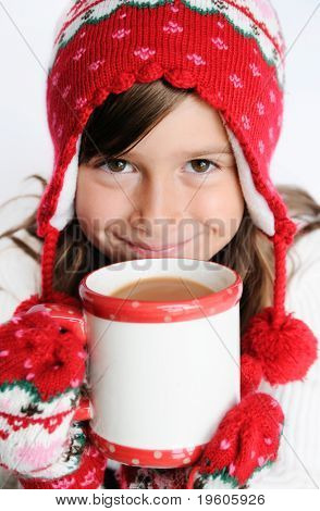A cute young girl drinking hot chocolate