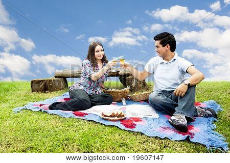 Picnic With Young And Happy Couple In Spring