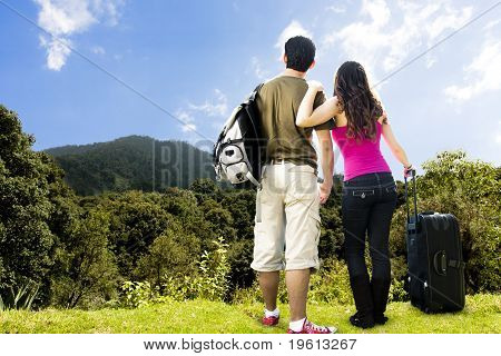Beautiful Couple Looking Afar From The Top Of A Mountain