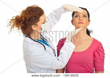 Plastic Doctor And Woman Prepare For Surgery
