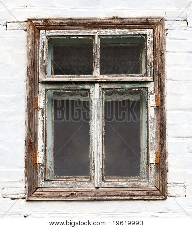 One old rusty window on white wall