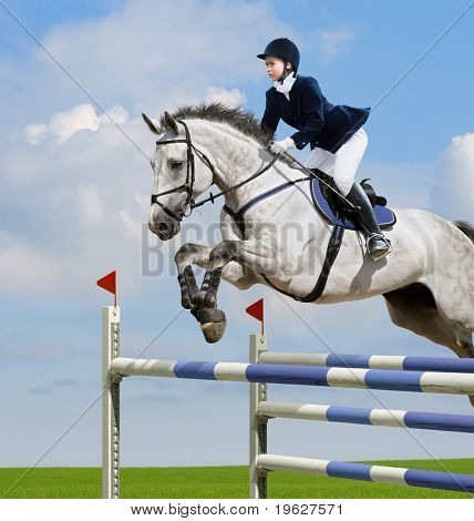 Young girl jumping with grey horse