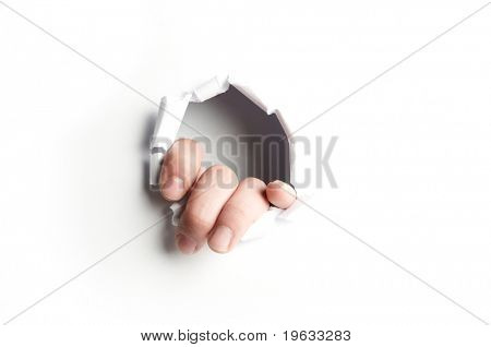 Hand showing trough a hole of a white paper