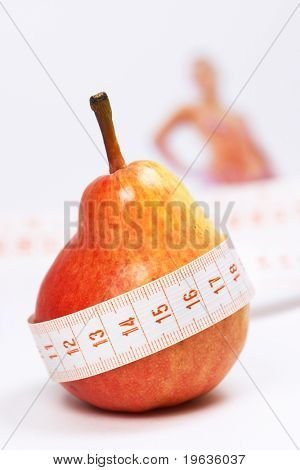 Overweight check-up (Red pear, blur woman on background)