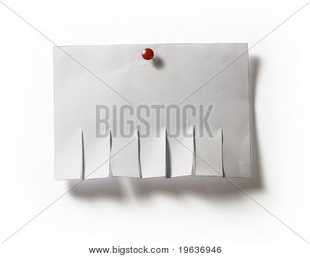 Closeup of advertisement template with tack. Isolated on white background with light shadow.