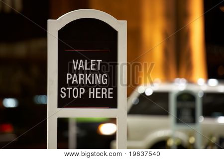 Closeup of Valet parking - stop here sign. Shallow focus depth
