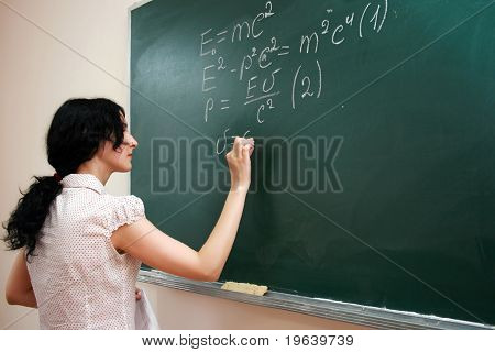 Girl Writing Formula At The Desk