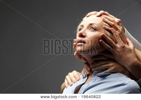 Portrait of a young businesswoman restrained by several hands