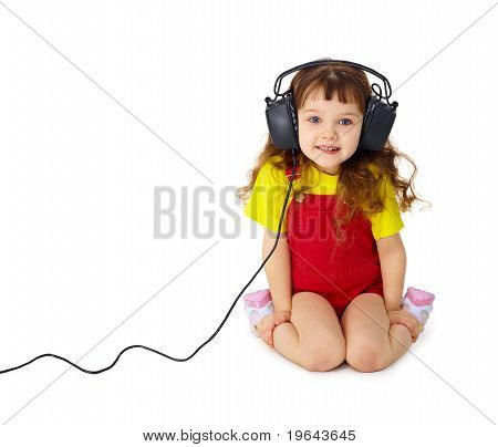 Child Listens Attentively To Music