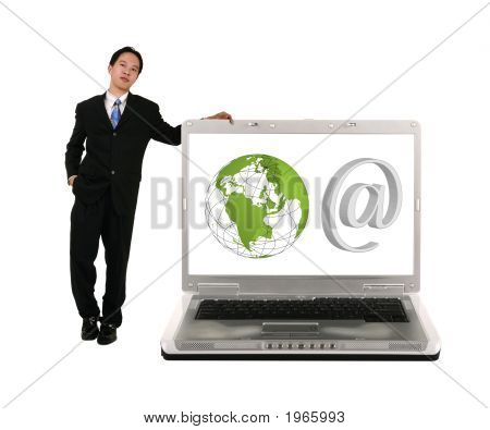 Leaning On Laptop With Internet Symbols