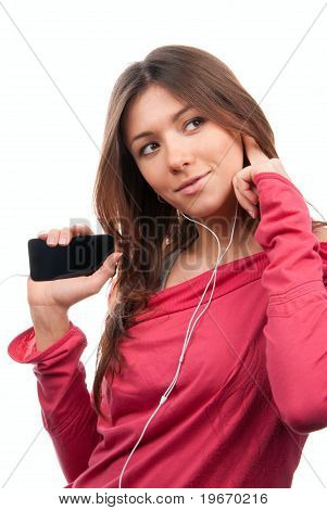 Young Womanl Listening, Enjoying Music And Holding Cellular Mp3 Player