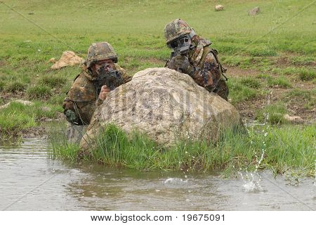 Soldiers Covering Behind The Rock