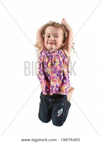 Adorable Little Girl Jumping In Air. Isolated On White Backgrou