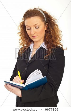 Redhead Business Woman Writing In Agenda