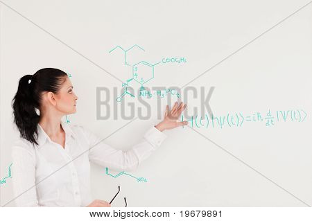Scientist Explaining A Formula Written On A White Board