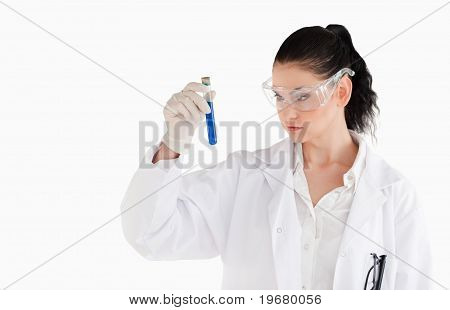Dark-haired Woman Carrying Out An Experiment