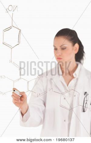 Dark-haired Scientist Writing A Formula On A White Board