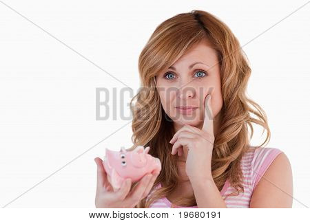 Blond-haired Woman Thoughtful While Holding Her Broken Piggybank