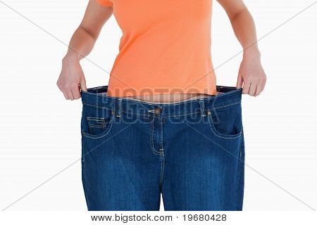 Slim Woman Showing How Much Weight She Lost