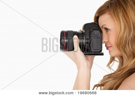 Pretty Blond-haired Woman Taking A Photo With A Camera