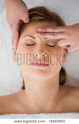 Young Blond-haired Woman Getting A Massage On Her Face