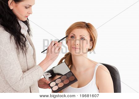 Cute Blond-haired Woman Having Her Make Up Done By A Make Up Artist