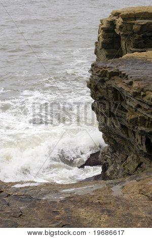 Surf against rocks
