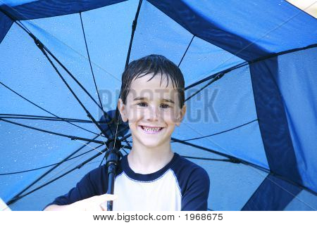 Boy In The Rain