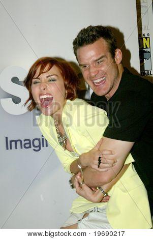 SAN DIEGO, CA - JULY 24: Allison Scaglotti & Eddie McClintock clown around in the