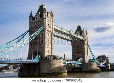 poster of Tower Bridge in London UK. Tower Bridge is a combined bascule and suspension bridge in London built between 1886 and 1894. The bridge crosses the River Thames close to the Tower of London and has become an iconic symbol of London.