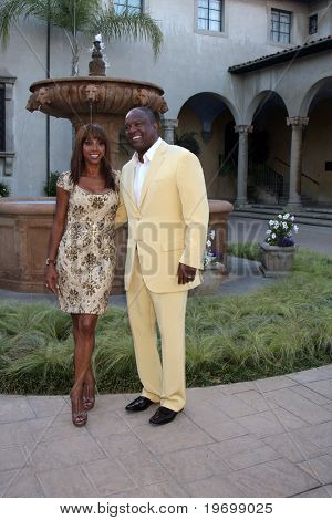 LOS ANGELES - JUL 24:  Holly Robinson Peete & Rodney Peete arrives at  the 12th Annual HollyRod Foundation DesignCare Event at Ron Burkle's Green Acres Estate on July24, 2010 in Beverly Hills, CA ....