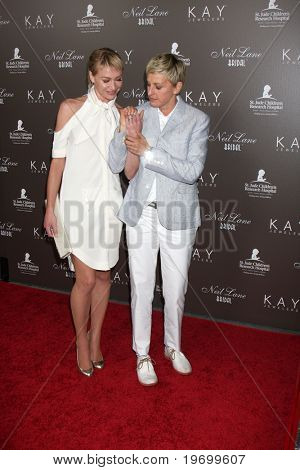 LOS ANGELES - JUL 22:  Portia DeRossi & Ellen DeGeneres arrive at the Neil Lane Bridal Collection Debut at Drai's at The W Hollywood Rooftop on July 22, 2010 in Los Angeles, CA ....