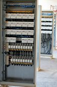 stock photo of busbar  - New control panels with static energy meters and circuit - JPG